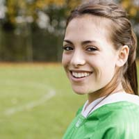 Girl smiling on soccer field